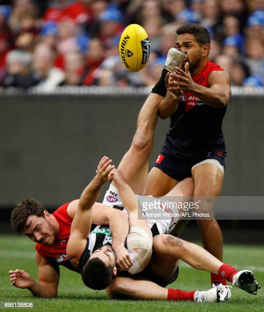 Michael Hibberd of the Demons tackles Alex Fasolo of the Magpies during the 2017 AFL round 12 match between the Melbourne Demons and the Collingwood...