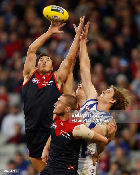 Michael Hibberd of the Demons Tom McDonald of the Demons and Ben Brown of the Kangaroos compete for the ball during the 2017 AFL round 09 match...