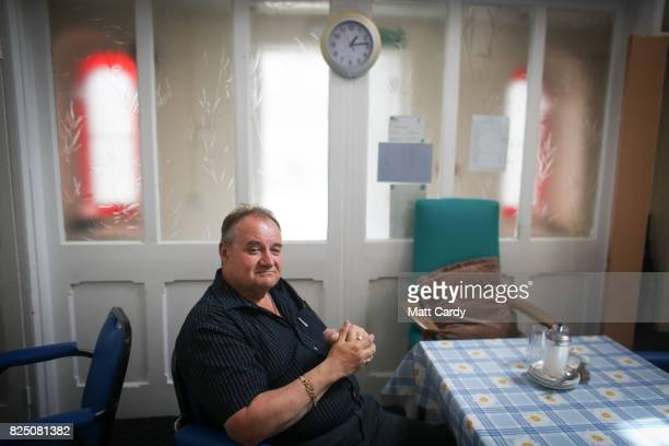 Michael Hichens a volunteer driver has been sleeping in his car for four weeks as he waits to be rehoused poses for a photograph at the Donald Thomas...