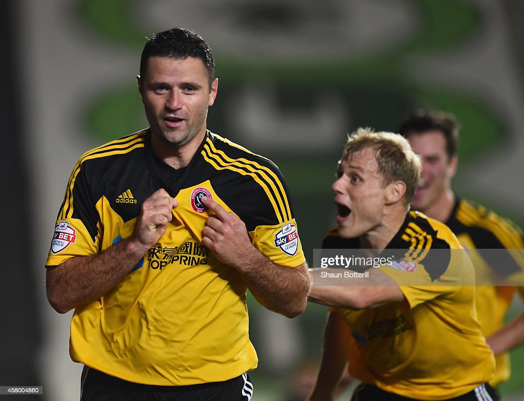 Michael Higdon of Sheefield United celebrates after scoring the winning goal during the Capital One Cup Fourth Round match between MK Dons and Sheffield United at Stadium mk on October 28, 2014 in Milton Keynes, England.