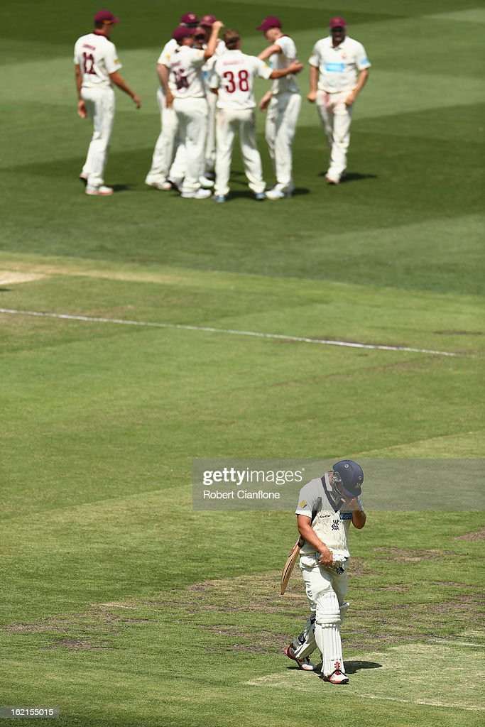 Michael Hill of the Bushrangers walks from the ground after he was dismissed during day three of the Sheffield Shield match between the Victorian Bushrangers and Queensland Bulls at the Melbourne Cricket Ground on February 20, 2013 in Melbourne, Australia.