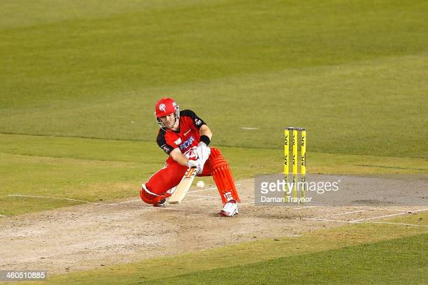 Michael Hill of the Renegades plays a ramp shot during the Big Bash League match between the Melbourne Renegades and the Melbourne Stars at Etihad...