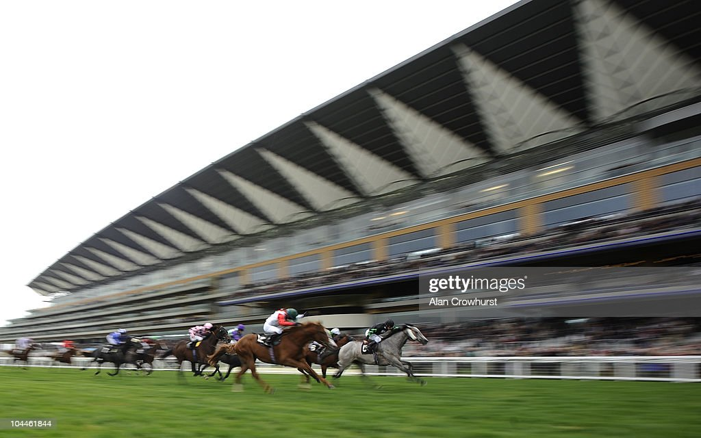 Michael Hills riding Capaill Liath (R) win The ABF Soldiers' Charity Nursery Handicap Stakes at Ascot racecourse on September 26, 2010 in Ascot, England