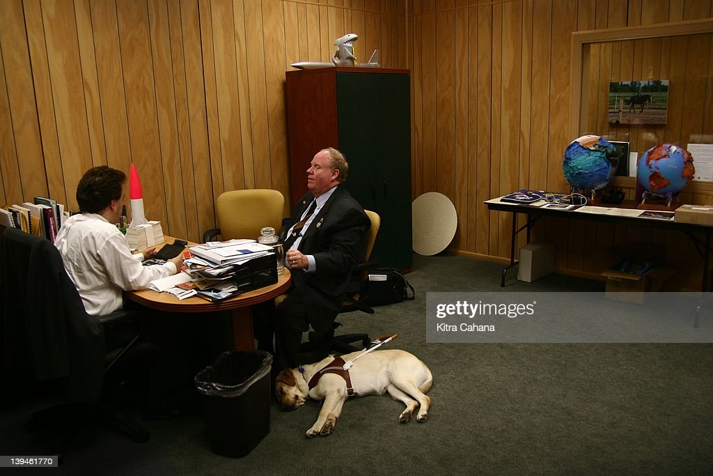 Michael Hingson, a successful blind businessman and sales manager who survived the September 11th terrorist attacks, speaks to an unidentified man on April 30, 2007 in Baltimore, Maryland. World Trade Center. Hingson was working on the 78th floor at the time of the attacks and immediately, along with his guide dog Roselle, stepped in to help guide other workers down the building. He is a spokesman for Guide Dogs For The Blind, an organization that promotes the use of guide dogs for visually impaired individuals.