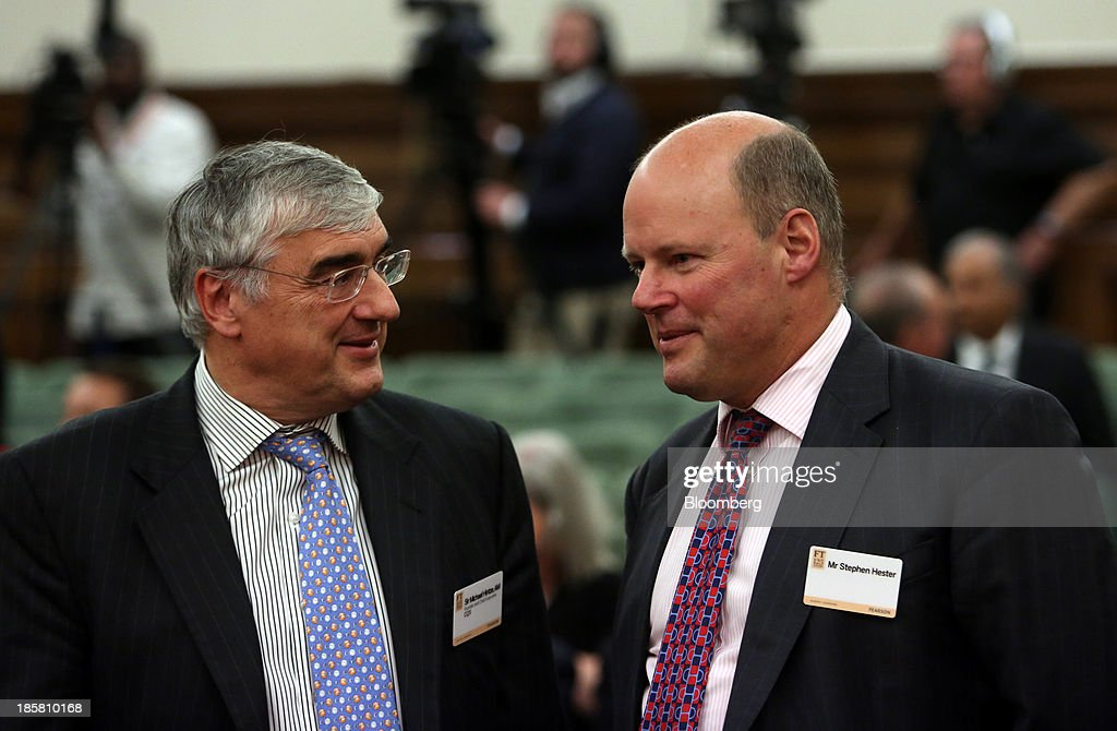Michael Hintze, founder and chief executive officer of CQS Management Ltd., left, speaks with Stephen Hester, chief executive officer of the Royal Bank of Scotland Group Plc (RBS)., during an event to mark the 125th anniversary of the Financial Times in London, U.K., on Thursday, Oct. 24, 2013. U.K. economic growth accelerated to its fastest pace in more than three years in the third quarter as the recovery continued across all main industries. Photographer: Chris Ratcliffe/Bloomberg via Getty Images