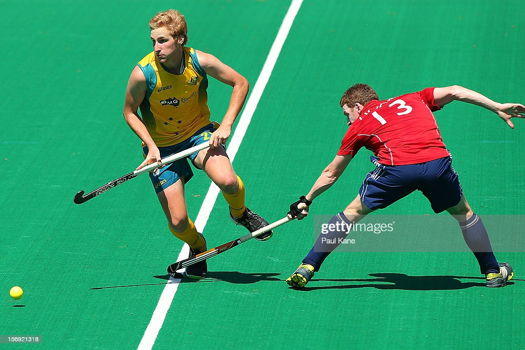 Michael Hoare of England tackles Daniel Beale of the Kookaburras in the gold medal match between the Australian Kookaburras and England during day four of the 2012 International Super Series at Perth Hockey Stadium on November 25, 2012 in Perth, Australia.