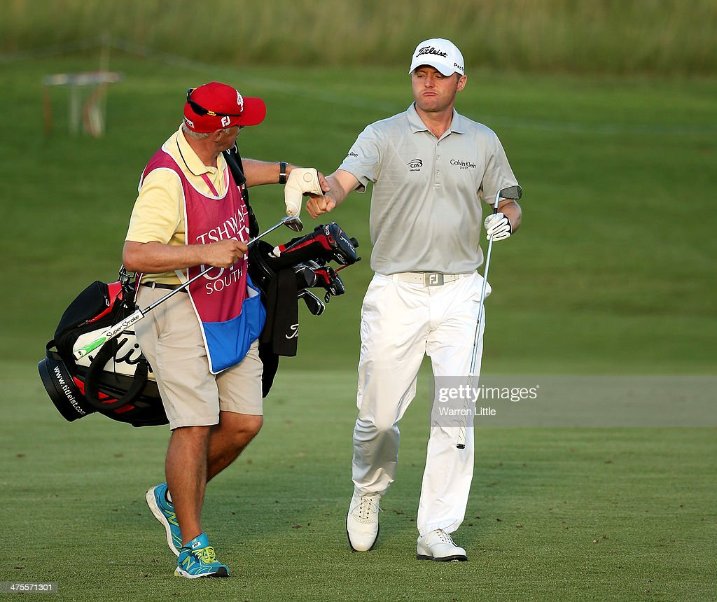 <a gi-track='captionPersonalityLinkClicked' href=/galleries/search?phrase=Michael+Hoey&family=editorial&specificpeople=600560 ng-click='$event.stopPropagation()'>Michael Hoey</a> of Northern Ireland and his caddie celebrate moments after he carded seven straight birdies during the second round of the Tshwane Open at Copperleaf Golf & Country Estate on February 28, 2014 in Centurion, South Africa.
