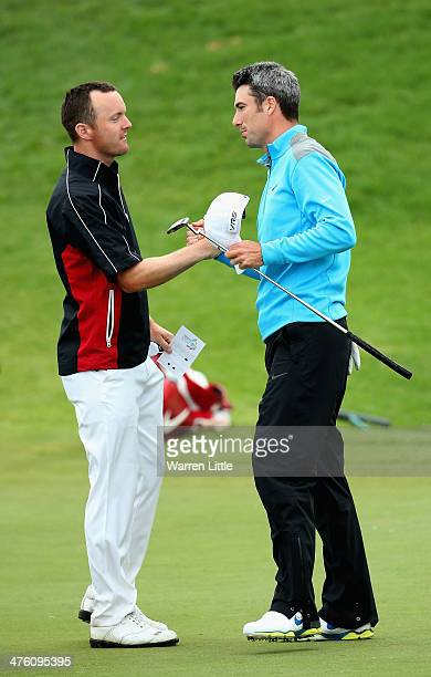 Michael Hoey of Northern Ireland congratulates Ross Fisher of England after winning the Tshwane Open at Copperleaf Golf Country Estate on March 2...