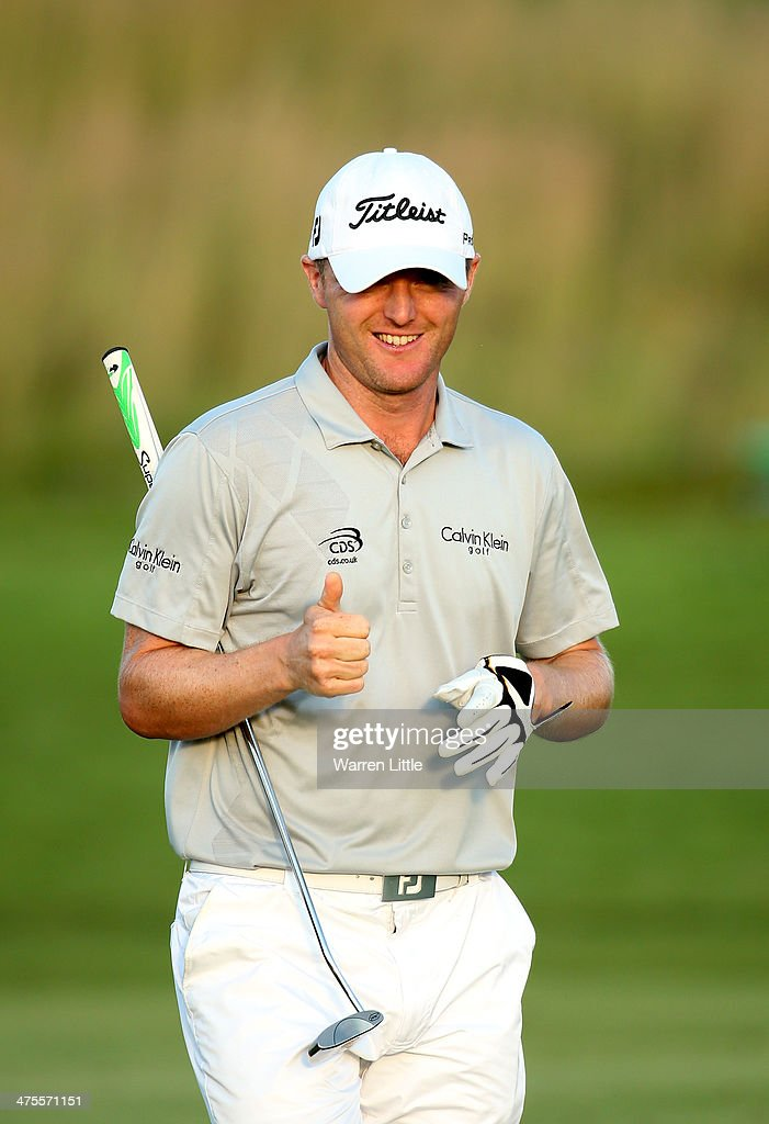 <a gi-track='captionPersonalityLinkClicked' href=/galleries/search?phrase=Michael+Hoey&family=editorial&specificpeople=600560 ng-click='$event.stopPropagation()'>Michael Hoey</a> of Northern Ireland gives a thumbs up as he cards seven straight birdies during the second round of the Tshwane Open at Copperleaf Golf & Country Estate on February 28, 2014 in Centurion, South Africa.