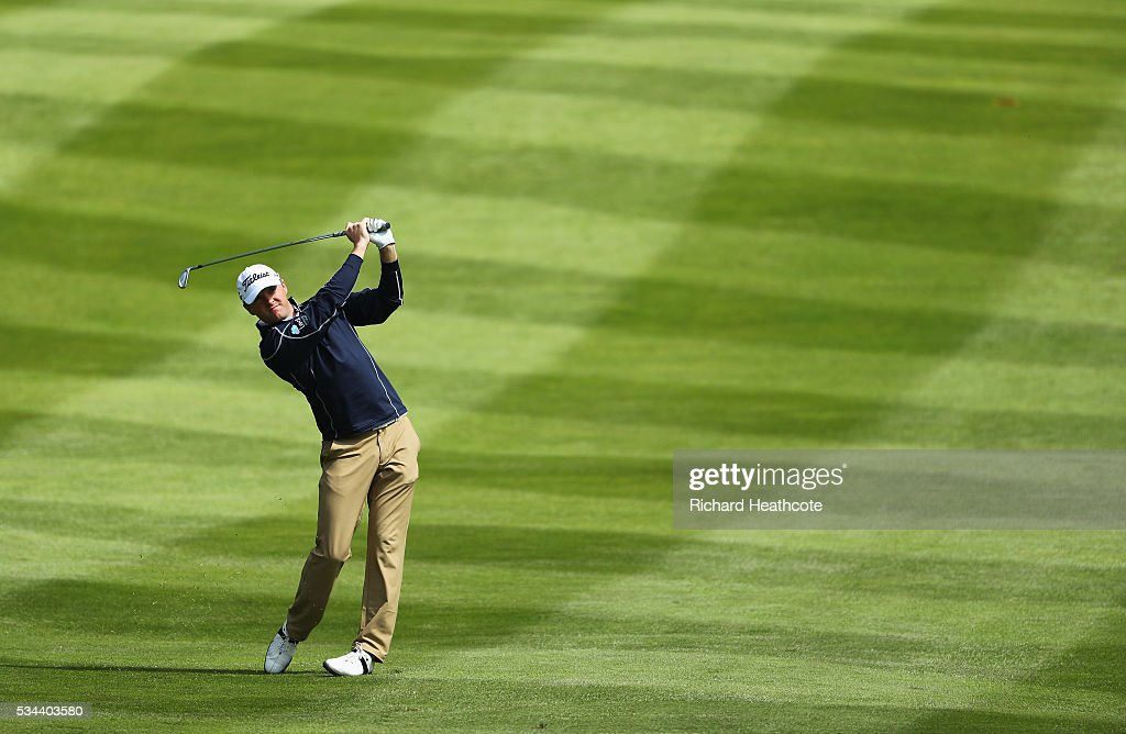 <a gi-track='captionPersonalityLinkClicked' href=/galleries/search?phrase=Michael+Hoey&family=editorial&specificpeople=600560 ng-click='$event.stopPropagation()'>Michael Hoey</a> of Northern Ireland hits his 2nd shot on the 4th hole during day one of the BMW PGA Championship at Wentworth on May 26, 2016 in Virginia Water, England.