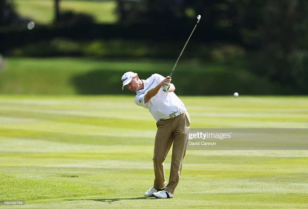 Michael Hoey of Northern Ireland hits his 2nd shot on the 9th hole during day one of the BMW PGA Championship at Wentworth on May 26, 2016 in Virginia Water, England.