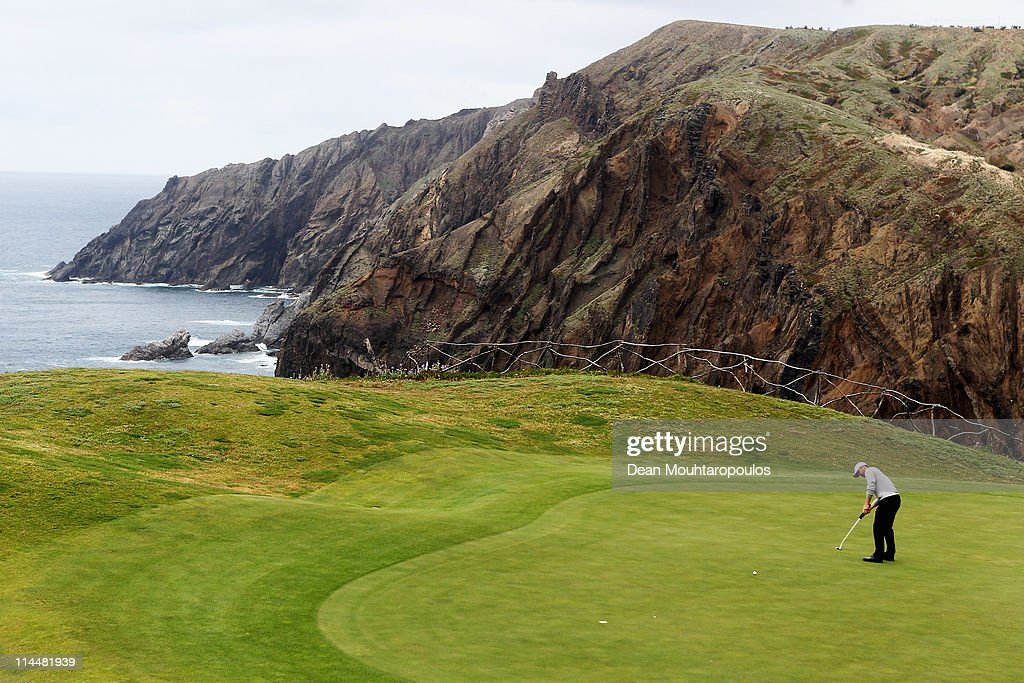 <a gi-track='captionPersonalityLinkClicked' href=/galleries/search?phrase=Michael+Hoey&family=editorial&specificpeople=600560 ng-click='$event.stopPropagation()'>Michael Hoey</a> of Northern Ireland hits his putt on the 13th hole during day three of the Madeira Islands Open on May 21, 2011 in Porto Santo Island, Portugal.