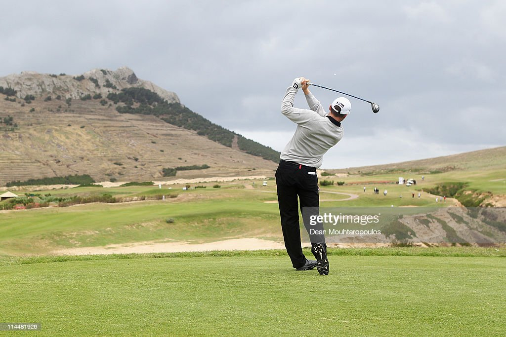 <a gi-track='captionPersonalityLinkClicked' href=/galleries/search?phrase=Michael+Hoey&family=editorial&specificpeople=600560 ng-click='$event.stopPropagation()'>Michael Hoey</a> of Northern Ireland hits his tee shot on the 14th hole during day three of the Madeira Islands Open on May 21, 2011 in Porto Santo Island, Portugal.