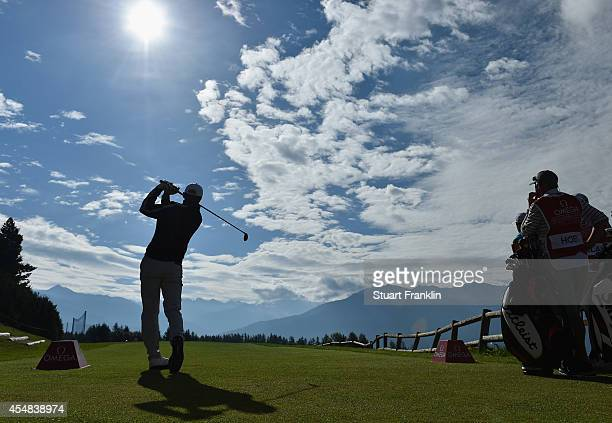 Michael Hoey of Northern Ireland plays a shot during the final round of the Omega European Masters at CranssurSierre Golf Club on September 7 2014 in...