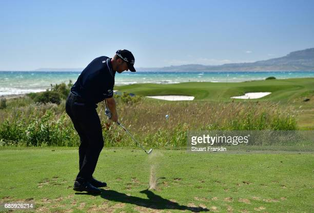 Michael Hoey of Northern Ireland plays a shot on the seventh hole during the third round of The Rocco Forte Open at The Verdura Golf and Spa Resort...