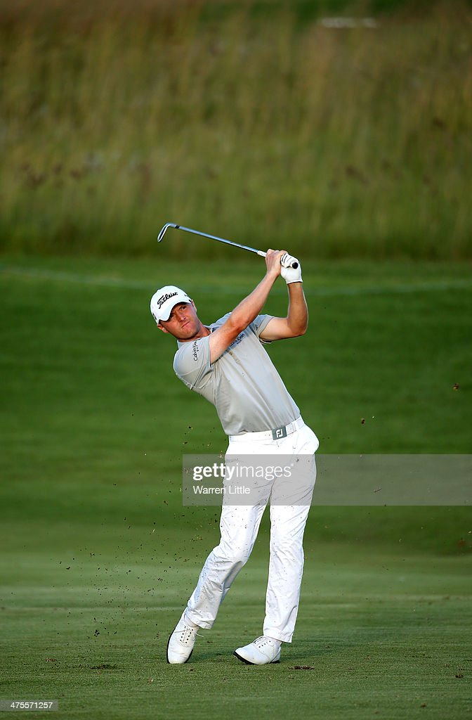 <a gi-track='captionPersonalityLinkClicked' href=/galleries/search?phrase=Michael+Hoey&family=editorial&specificpeople=600560 ng-click='$event.stopPropagation()'>Michael Hoey</a> of Northern Ireland plays his second shot into the 18th green during the second round of the Tshwane Open at Copperleaf Golf & Country Estate on February 28, 2014 in Centurion, South Africa.