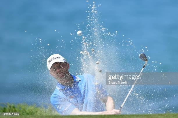 Michael Hoey of Northern Ireland plays out of a bunker on the 15th hole during the second round of The Rocco Forte Open at The Verdura Golf and Spa...