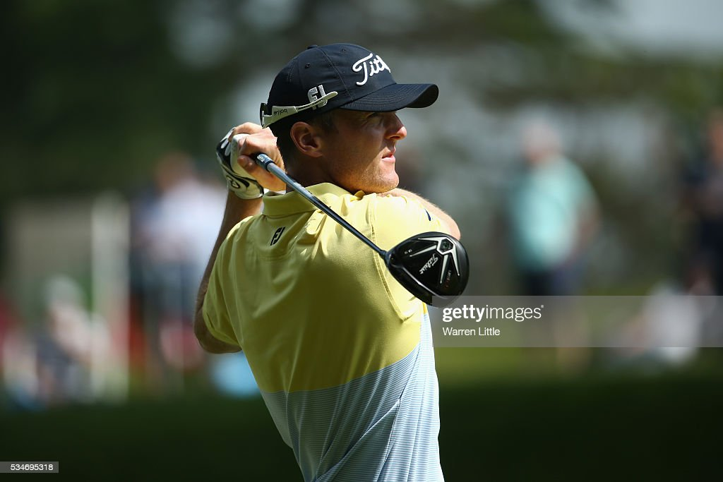 <a gi-track='captionPersonalityLinkClicked' href=/galleries/search?phrase=Michael+Hoey&family=editorial&specificpeople=600560 ng-click='$event.stopPropagation()'>Michael Hoey</a> of Northern Ireland tees off on the 3rd hole during day two of the BMW PGA Championship at Wentworth on May 27, 2016 in Virginia Water, England.