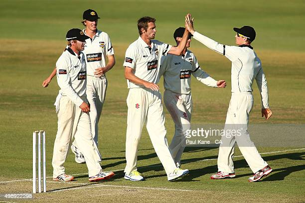 Michael Hogan and Cameron Bancroft of Western Australia celebrate the wicket of Fawad Ahmed of Victoria during day one of the Sheffield Shield match...