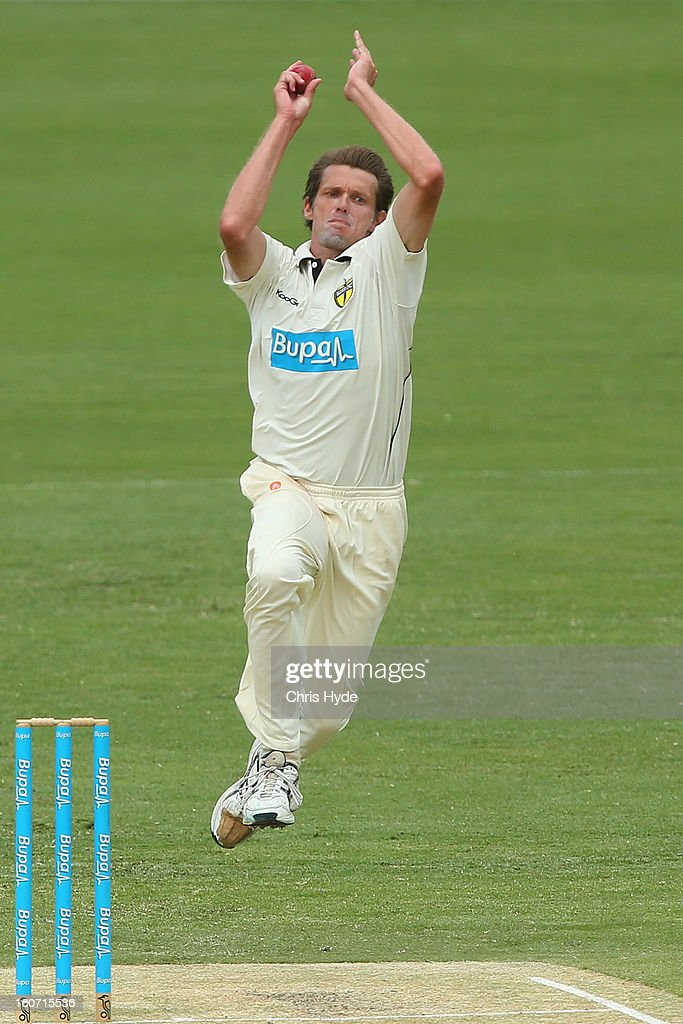 Michael Hogan of the Warriors bowls during day two of the Sheffield Shield match between the Queensland Bulls and the Western Australia Warriors at The Gabba on February 5, 2013 in Brisbane, Australia.