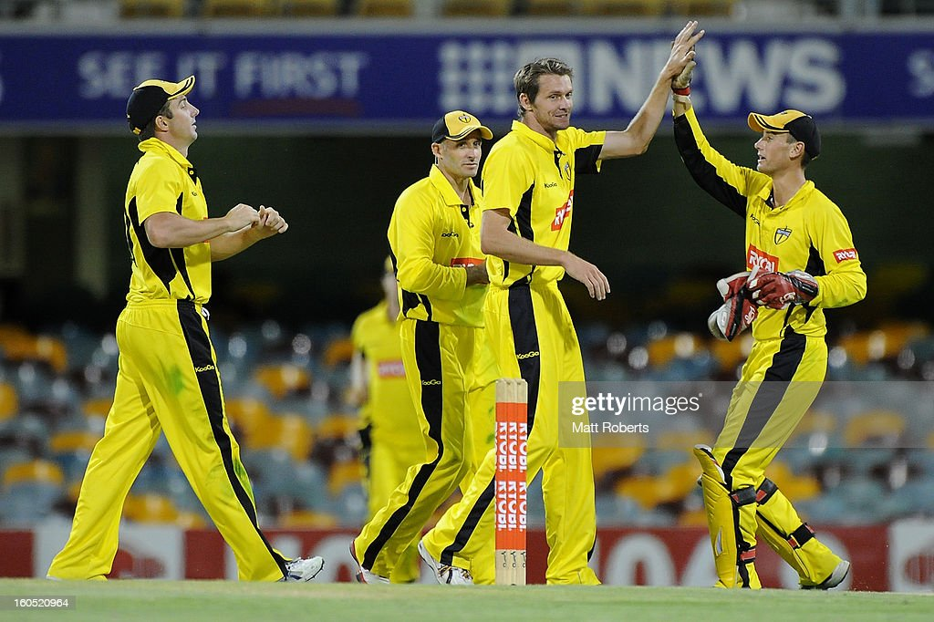 Michael Hogan of the Warriors celebrates a wicket with team mates during the Ryobi One Day Cup match between the Queensland Bulls and the Western Australia Warriors at The Gabba on February 2, 2013 in Brisbane, Australia.