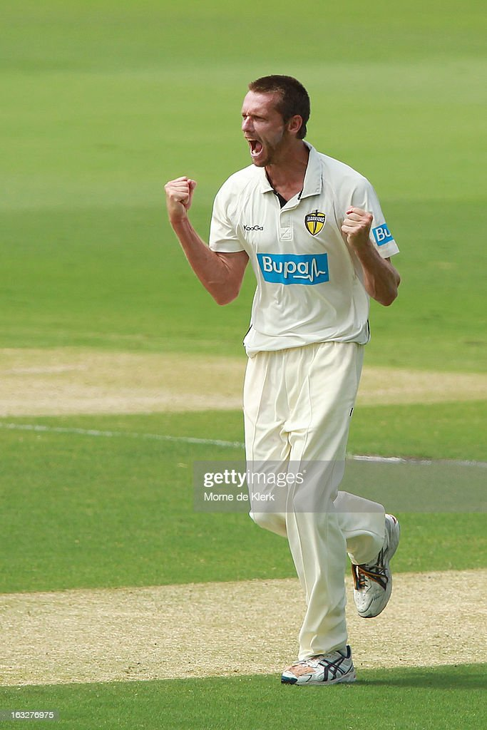 Michael Hogan (C) of the Warriors celebrates after he got the wicket of Michael Klinger of the Redbacks during day one of the Sheffield Shield match between the South Australian redbacks and the Western Australia Warriors at Adelaide Oval on March 7, 2013 in Adelaide, Australia.