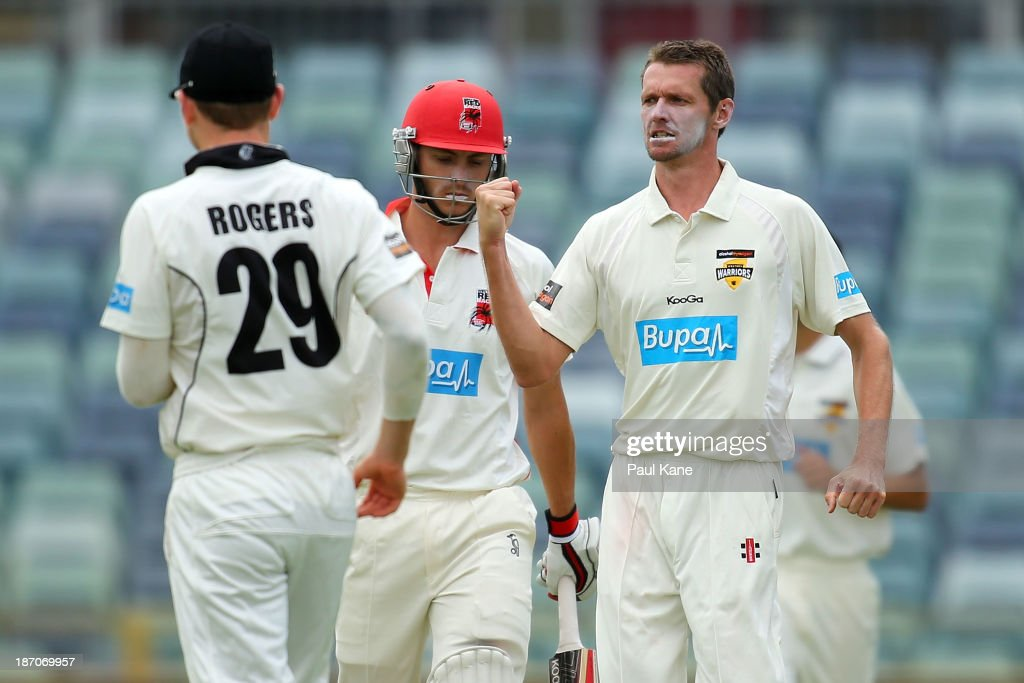 Michael Hogan of the Warriors celebrates the wicket of Sam Raphael of the Redbacks during day one of the Sheffield Shield match between the Western Australia Warriors and the South Australia Redbacks at the WACA on November 6, 2013 in Perth, Australia.