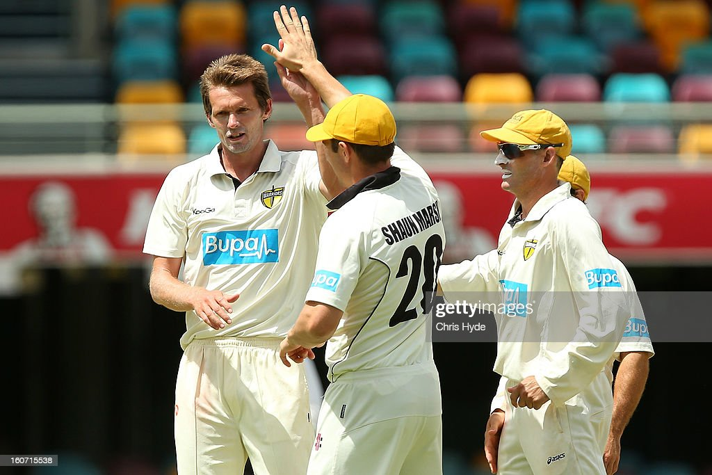Michael Hogan of the Warriors celebrates with team mates after dismissing Matthew Gale of the Bulls during day two of the Sheffield Shield match between the Queensland Bulls and the Western Australia Warriors at The Gabba on February 5, 2013 in Brisbane, Australia.