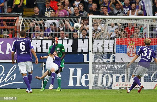 Michael Hohnstedt scores during the Third League match between VfL Osnabrueck and Hansa Rostock at Osnatel Arena on August 17 2013 in Osnabruck...