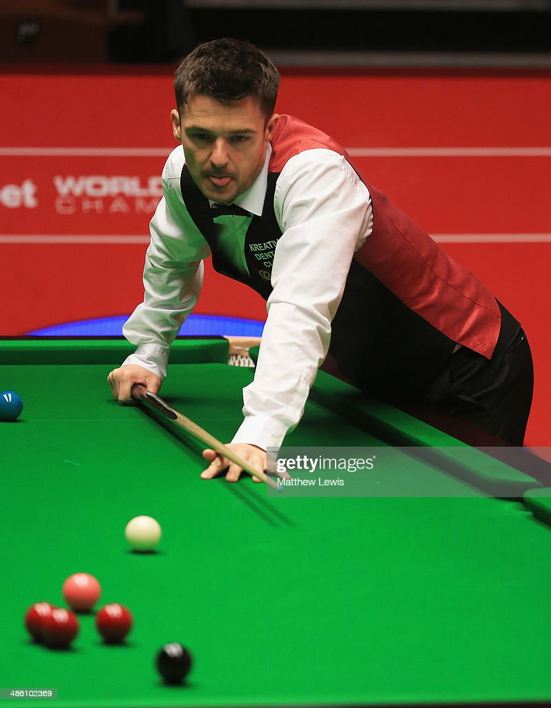 Michael Holt of England in action against Mark Allen of Northern Ireland during day four of the The Dafabet World Snooker Championship at Crucible Theatre on April 21, 2014 in Sheffield, England.