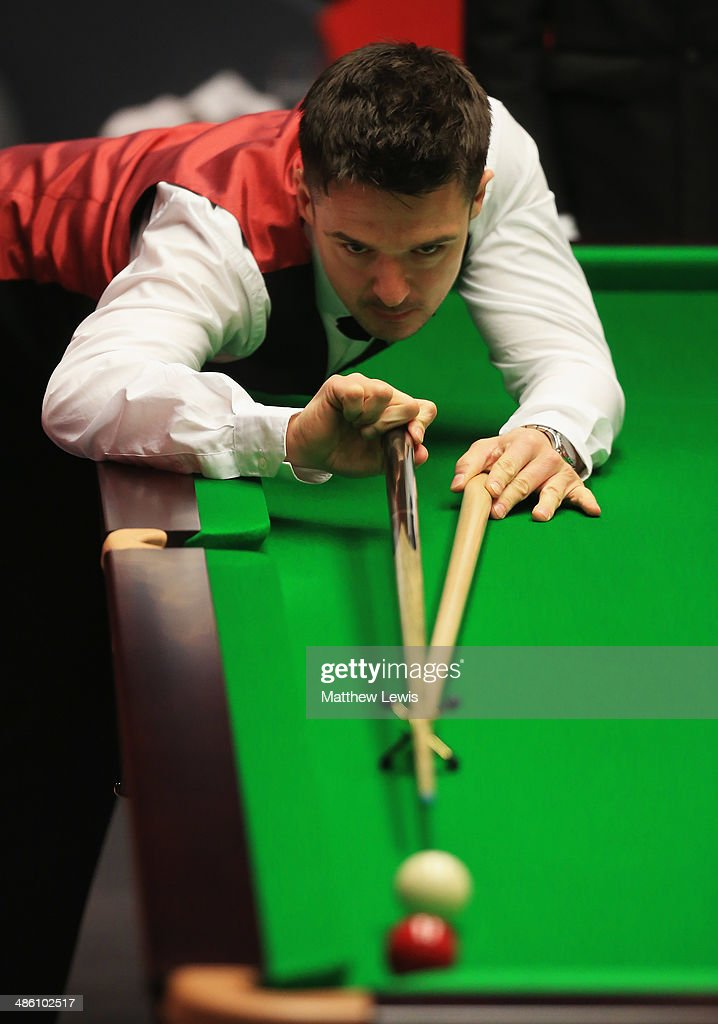 <a gi-track='captionPersonalityLinkClicked' href=/galleries/search?phrase=Michael+Holt&family=editorial&specificpeople=680689 ng-click='$event.stopPropagation()'>Michael Holt</a> of England in action against Mark Allen of Northern Ireland during day four of the The Dafabet World Snooker Championship at Crucible Theatre on April 21, 2014 in Sheffield, England.