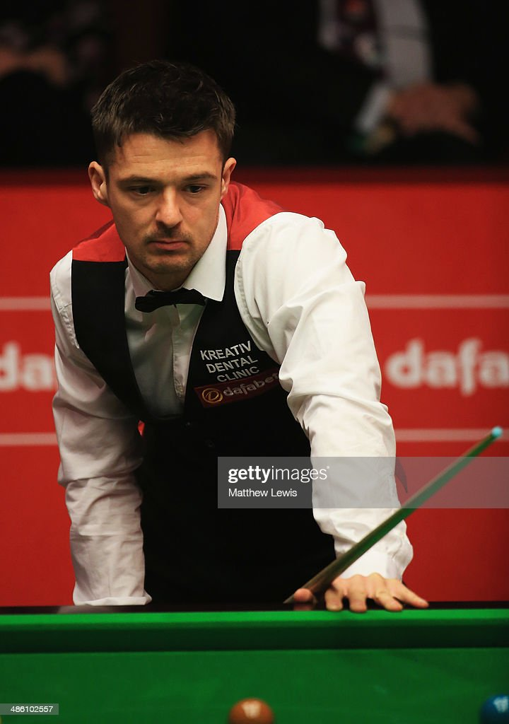 Michael Holt of England looks on during his match against Mark Allen of Northern Ireland during day four of the The Dafabet World Snooker Championship at Crucible Theatre on April 21, 2014 in Sheffield, England.