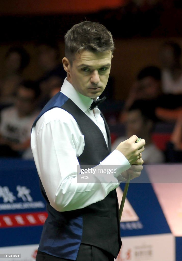 Michael Holt of England looks on in the match against Martin Gould of England on day four of the 2013 World Snooker Shanghai Master at Shanghai Grand Stage on September 19, 2013 in Shanghai, China.