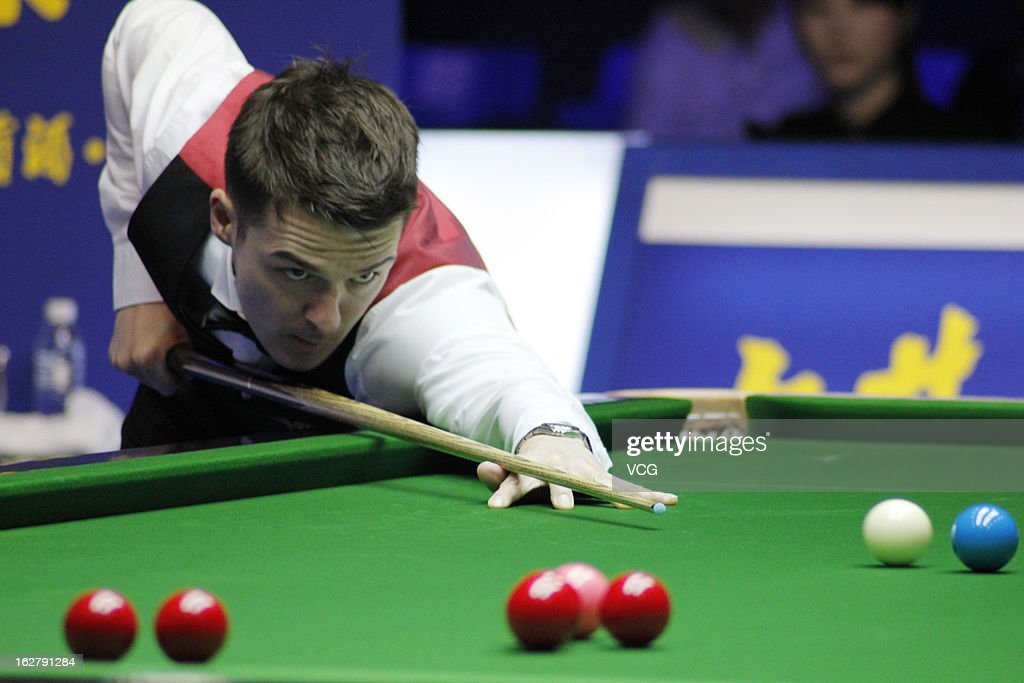 Michael Holt of England plays a shot during the match against Ding Junhui of China on day three of the 2013 World Snooker Haikou Open at Haikou Convention and Exhibition Center on February 27, 2013 in Haikou, China.