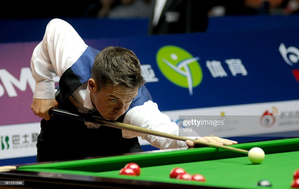 Michael Holt of England plays a shot in the match against Martin Gould of England on day four of the 2013 World Snooker Shanghai Master at Shanghai Grand Stage on September 19, 2013 in Shanghai, China.