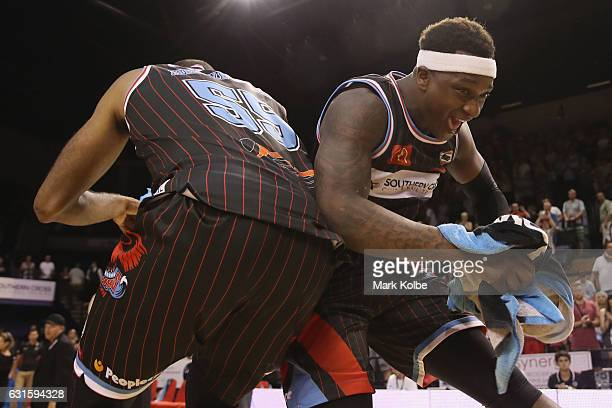 Michael Holyfield and Marvelle Harris of the Hawks celebrate victory during the round five NBL match between the Illawarra Hawks and the Brisbane...
