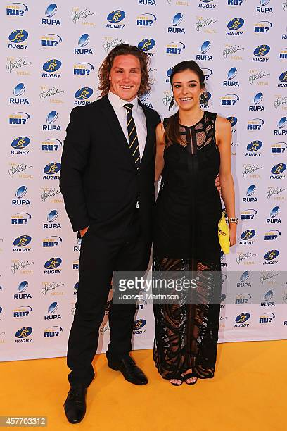Michael Hooper and Kate Howard arrive ahead of the 2014 John Eales Medal at Royal Randwick Racecourse on October 23 2014 in Sydney Australia