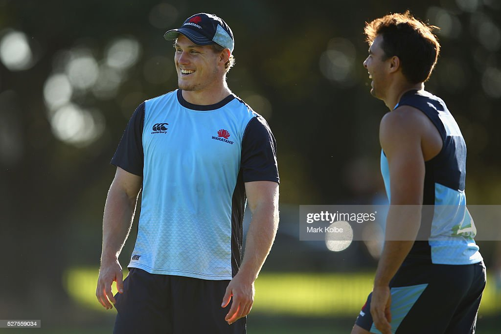 Michael Hooper and Nick Phipps share a joke during a Waratahs Super Rugby training session at Kippax Lake on May 3, 2016 in Sydney, Australia.