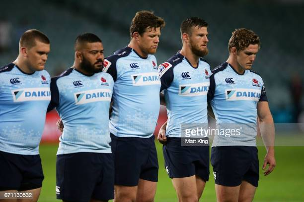 Michael Hooper captain of the Waratahs and team mates take part in the ANZAC ceremony during the round nine Super Rugby match between the Waratahs...