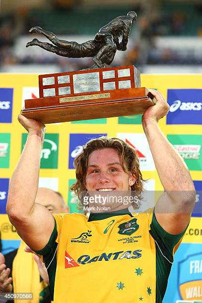 Michael Hooper holds up the trophy after the International Test match between the Australia Wallabies and France at Allianz Stadium on June 21 2014...
