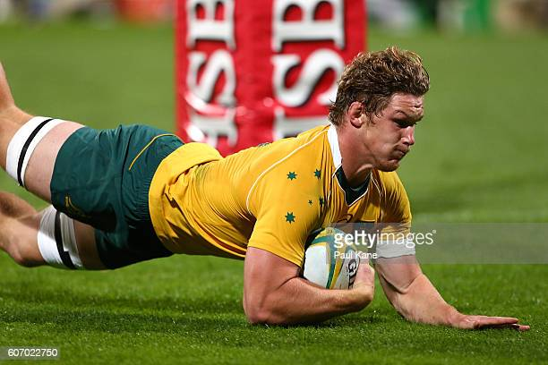 Michael Hooper of Australia dives for a try during the Rugby Championship match between the Australian Wallabies and Argentina at nib Stadium on...