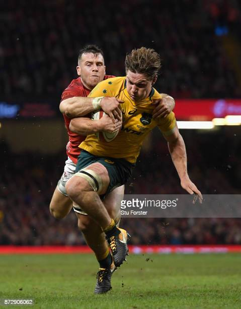 Michael Hooper of Australia dives over to score for the Qantas Wallabies despite the attempted tackle of Gareth Davies of Wales during the...