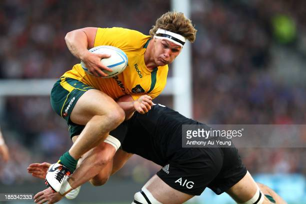 Michael Hooper of Australia is tackled by Jeremy Thrush of New Zealand during The Rugby Championship match between the New Zealand All Blacks and the...