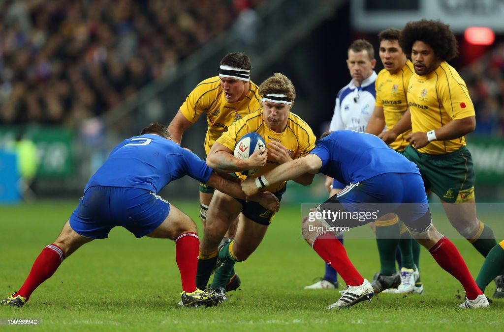 Michael Hooper of Australia is tackled by Nicolas Mas of France during the Autumn International match between France and Australia at Stade de France on November 10, 2012 in Paris, France.