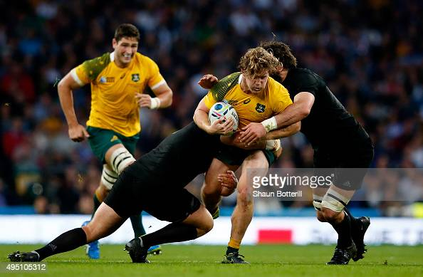 Michael Hooper of Australia is tackled during the 2015 Rugby World Cup Final match between New Zealand and Australia at Twickenham Stadium on October...