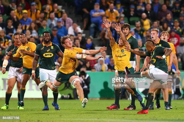 Michael Hooper of Australia runs down a field goal attempt to win the game by Elton Jantjies of South Africa during The Rugby Championship match...
