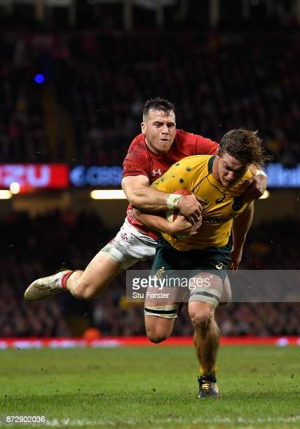 Michael Hooper of Australia touches downn for the third try with Gareth Davies of Wales attempting to stop him during the Under Armour Series match...