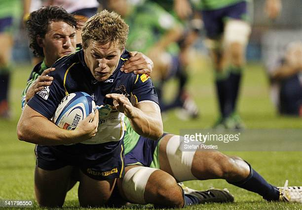 Michael Hooper of the Brumbies scores a try during the round five Super Rugby match between the Brumbies and the Highlanders at Canberra Stadium on...