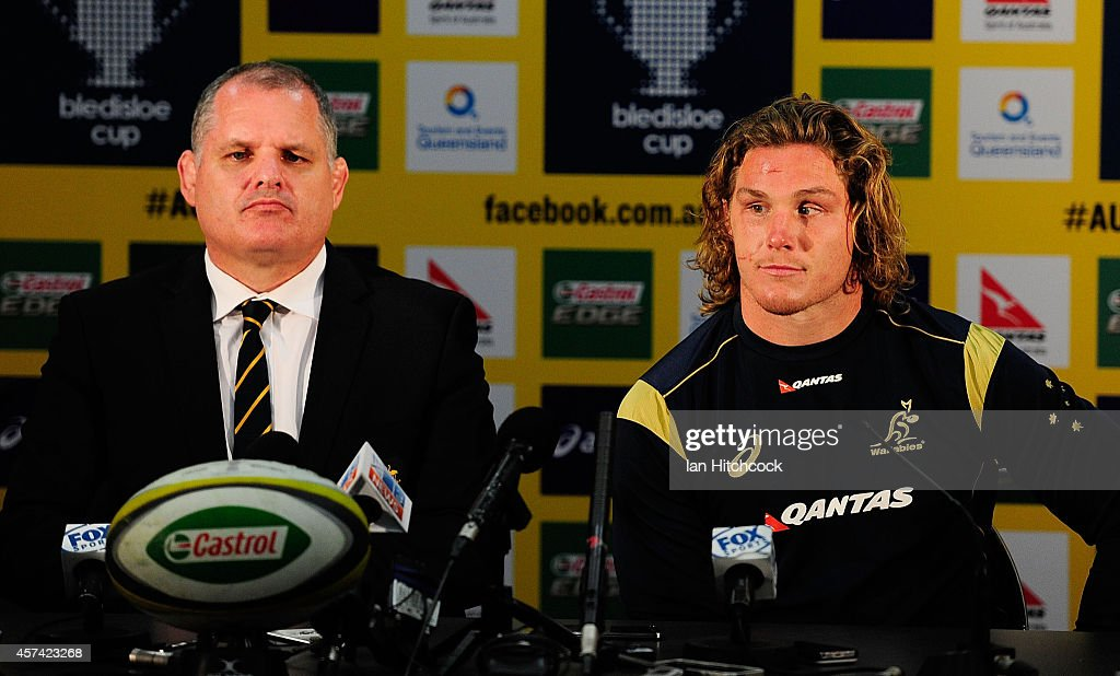 Michael Hooper of the Wallabies and coach Ewen McKenzie look on in the post match press conference at the end of The Rugby Championship match between...