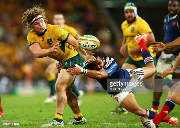 Michael Hooper of the Wallabies offloads during the First International Test Match between the Australian Wallabies and France at Suncorp Stadium on...